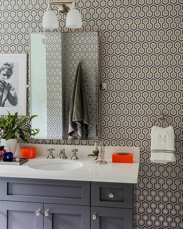 Contemporary gray bathroom boasts a wall clad in Hicks