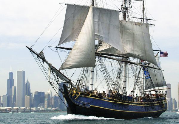 Photograph by Jeff Haynes, FP/Getty Images | The H.M.S. Bounty sails past the Chicago skyline during a 2003 tall-ship festival. When the Bounty set sail last Thursday from Connecticut en route for St. Petersburg, Florida, Captain Walbridge expressed optimism that his crew could navigate around the hurricane.