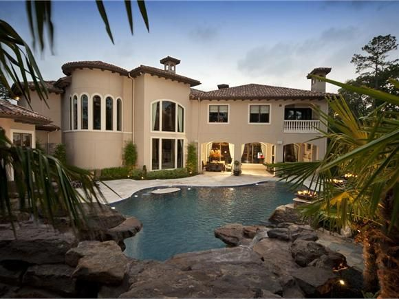 Attirant A Stone Waterfall Flanked By Palm Trees Frames The Pool And Covered Lanai  Of This Custom Home. The Insignia Series From Design Tech Homes.