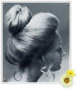 1970s Soft Bun Hair 1970s Hairstyles Boho Hairstyles Flowers In Hair