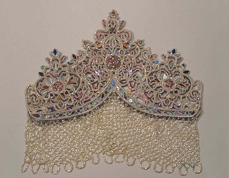 Maiden's Headdress, Kostroma Province, Russia, circa early 19th century.  Made of linen, cord, copper, foil, mother-of-pearl, glass, spangles and linen thread; braiding and embroidery. 28 x 33 cm.