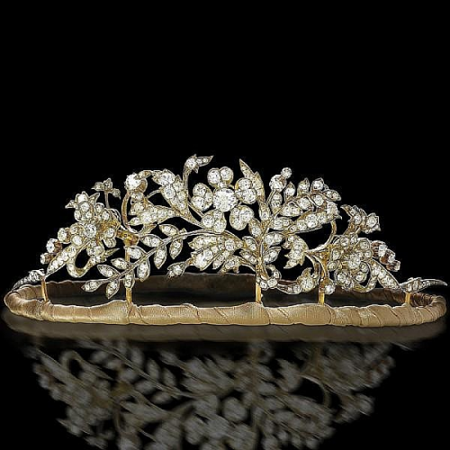 A 19th century diamond tiara, circa 1850 Designed as a floral and foliate garland of old brilliant, rose and cushion-shaped diamonds, the three principal flowerheads en tremblant, mounted in silver and gold, cushion-shaped and old brilliant-cut diamonds approximately 14.00 carats total, detachable to form three brooches and the centrepiece of a necklace, height at tallest point 5.5cm, fitted case by Tessier, New Bond Street .