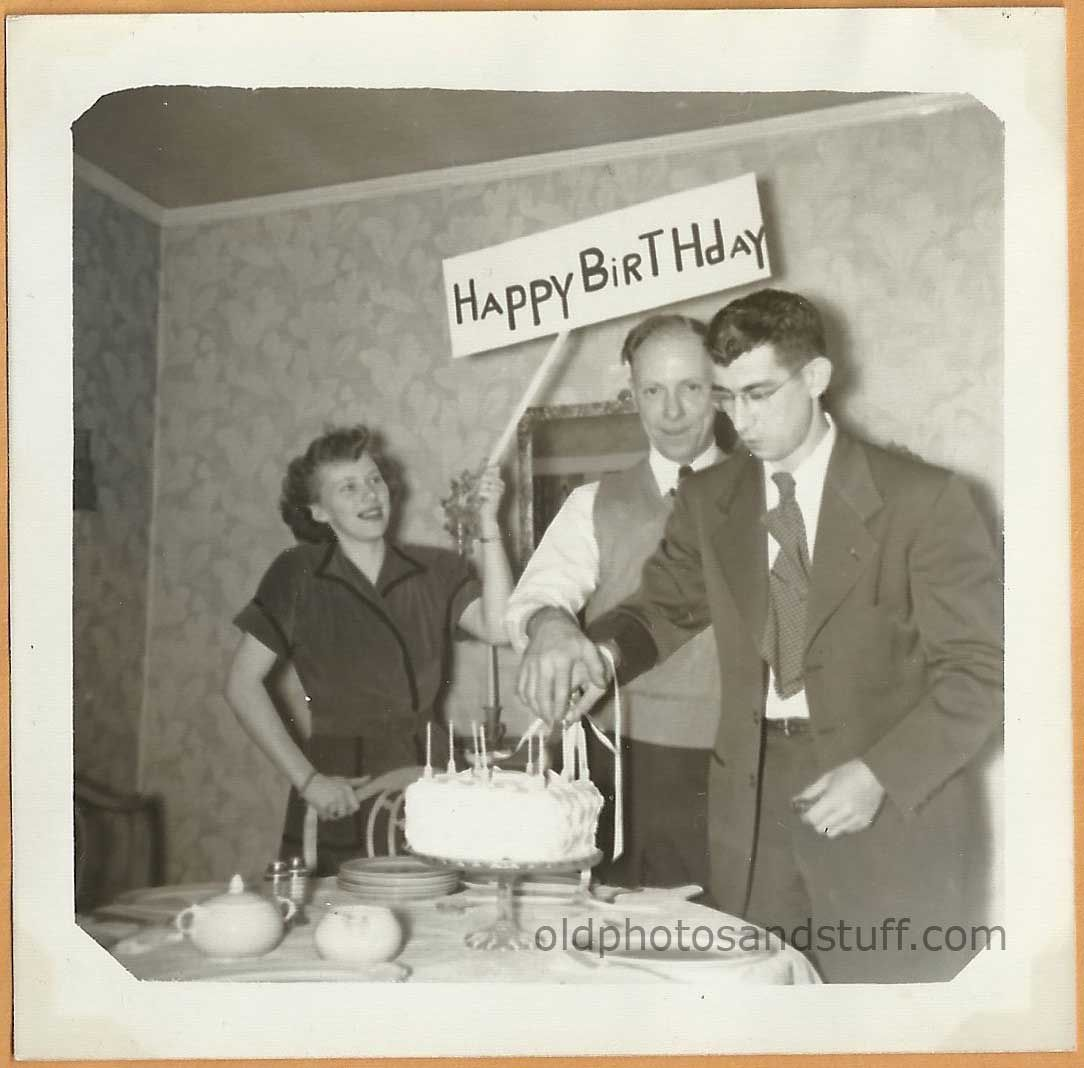 Vintage snapshot of two men cutting a birthday cake 1950s For