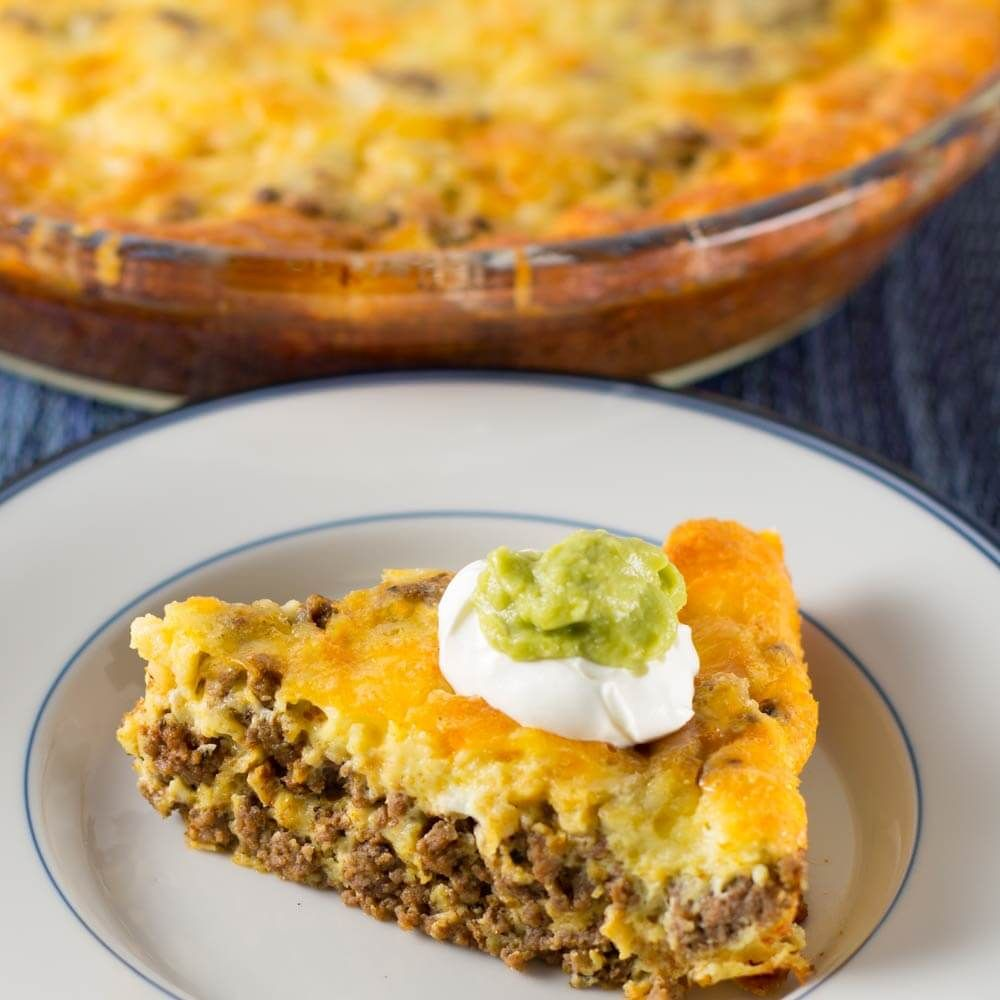 This crustless low carb taco pie is so good, you won't miss the carbs. Even those who don't follow a ketogenic diet will love it. Taco seasoning recipe too!