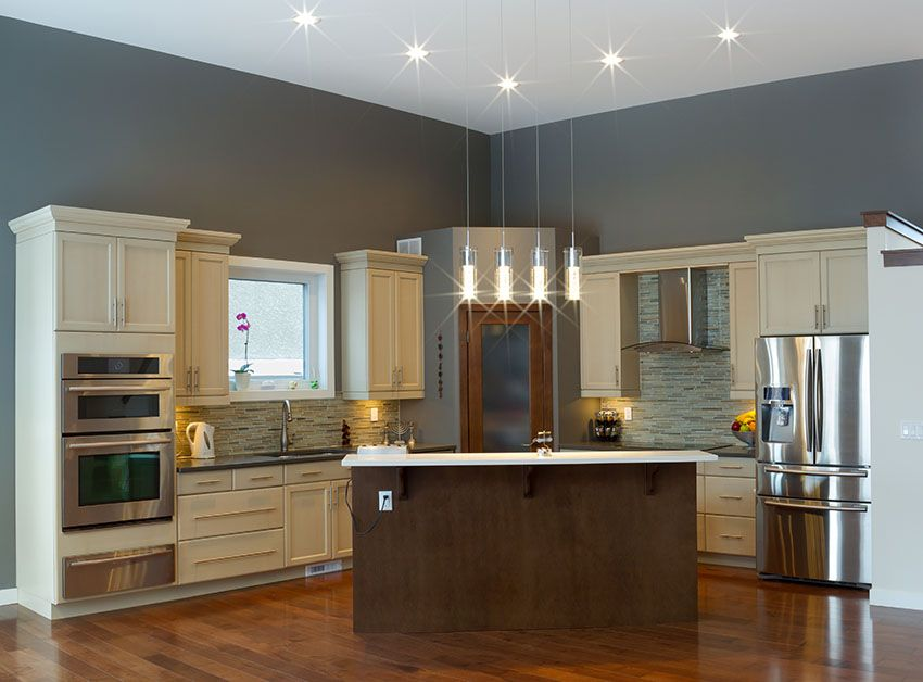 Off white cabinet kitchen with gray walls, wood island and ...