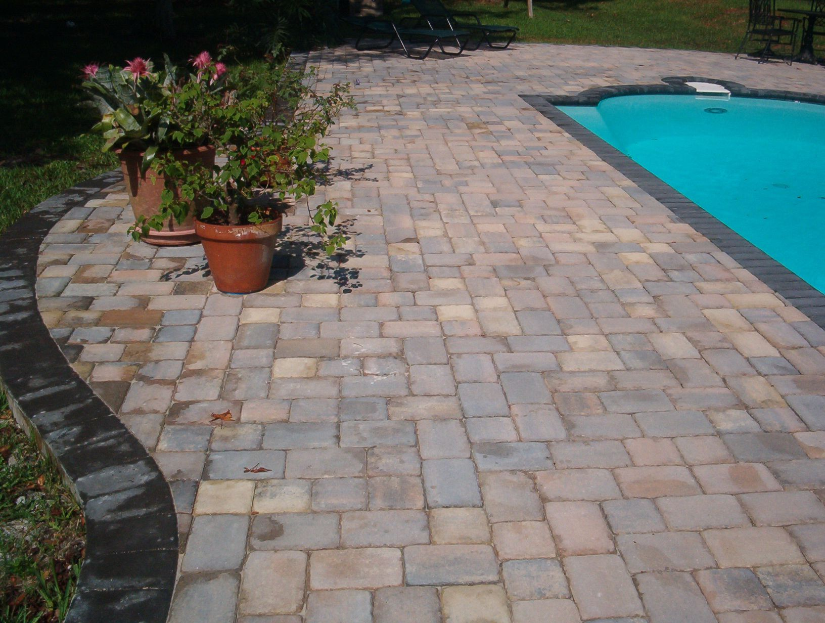 Custom old chicago pavers with charcoal border pool deck for Best pavers for pool deck