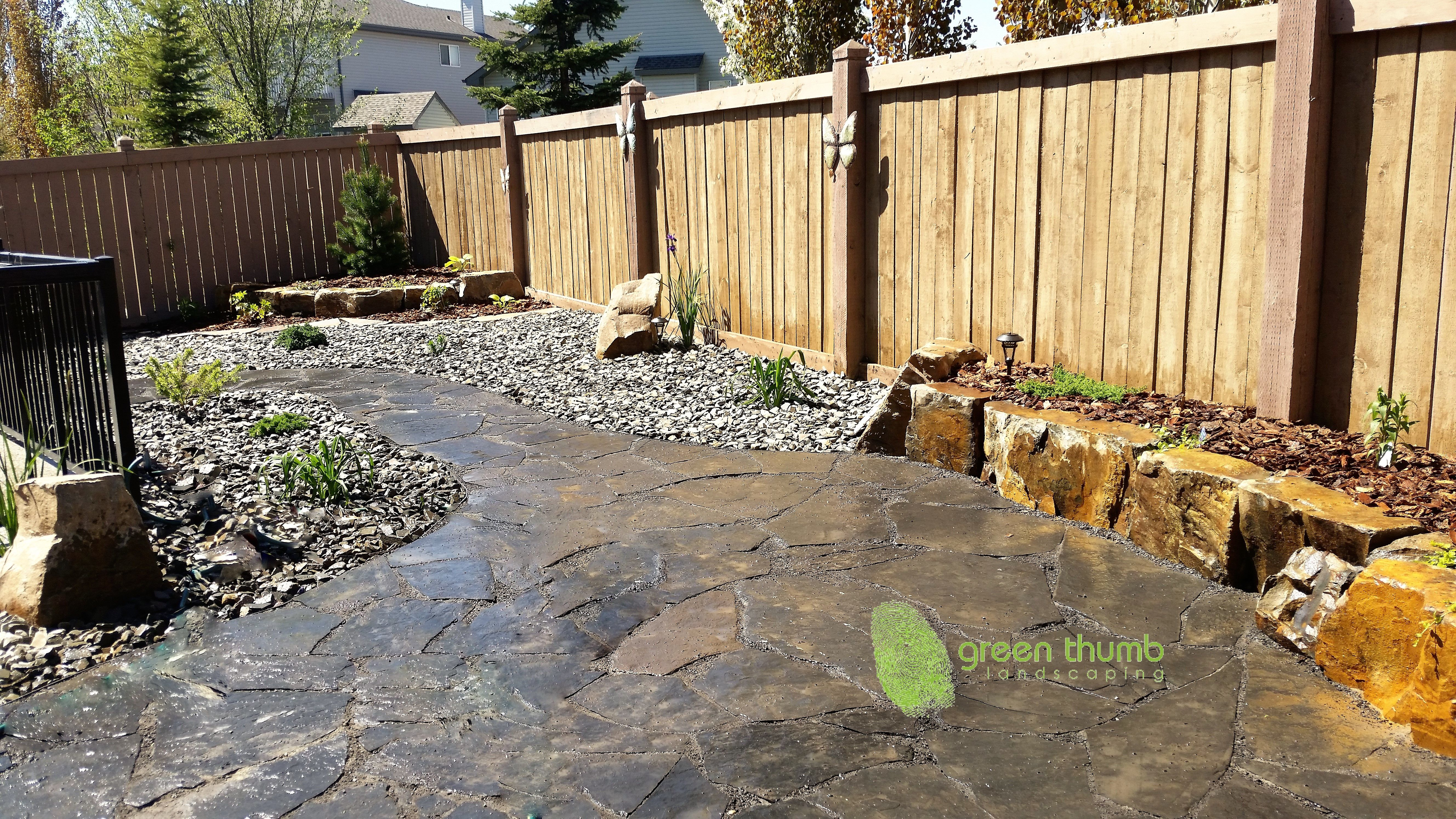 A Rundle Flagstone patio in a small low maintenance back yard The