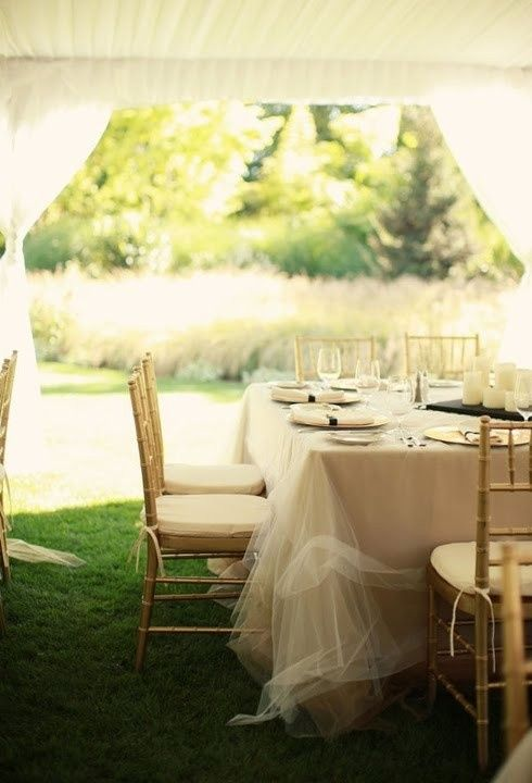 tulle in white or pinks/peaches/creams to lay over ivory plastic tablecloths