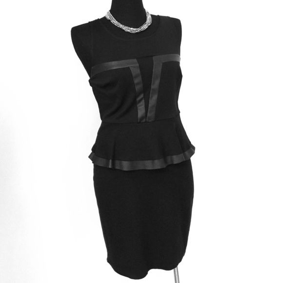 LIKE NEW! Express Peplum Dress This dress is in like new condition without any stains defects or signs of wear. It has a peplum around the waist with faux leather trim. It has an exterior zipper with meshwork above the chest area. The fabric is made up of 65% rayon 30% nylon and 5% spandex. The yoke is 80% nylon and 20% spandex. Express Dresses Midi