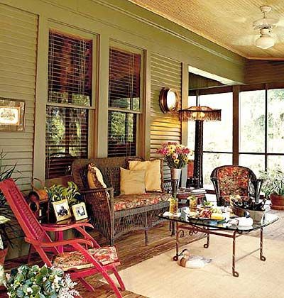 A porch with red wooden furniture.
