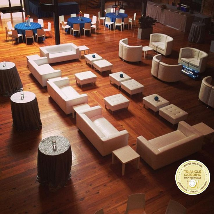 Large lounge area with white couches and ottomans at a corporate ...