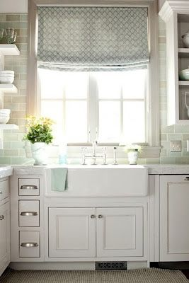 Charming cottage kitchen with farmhouse sink and beach inspired glass tiles also really like the window treatment gorgeous gray white kitchens pinterest