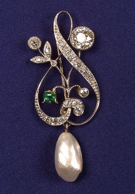 Edwardian Diamond, Pearl and Emerald Pin, the scrolling floral design set with old European-cut diamonds, approx. total wt. 1.5 cts., with freshwater pearl drop, emerald highlight, millegrain accents, (replaced pin stem).