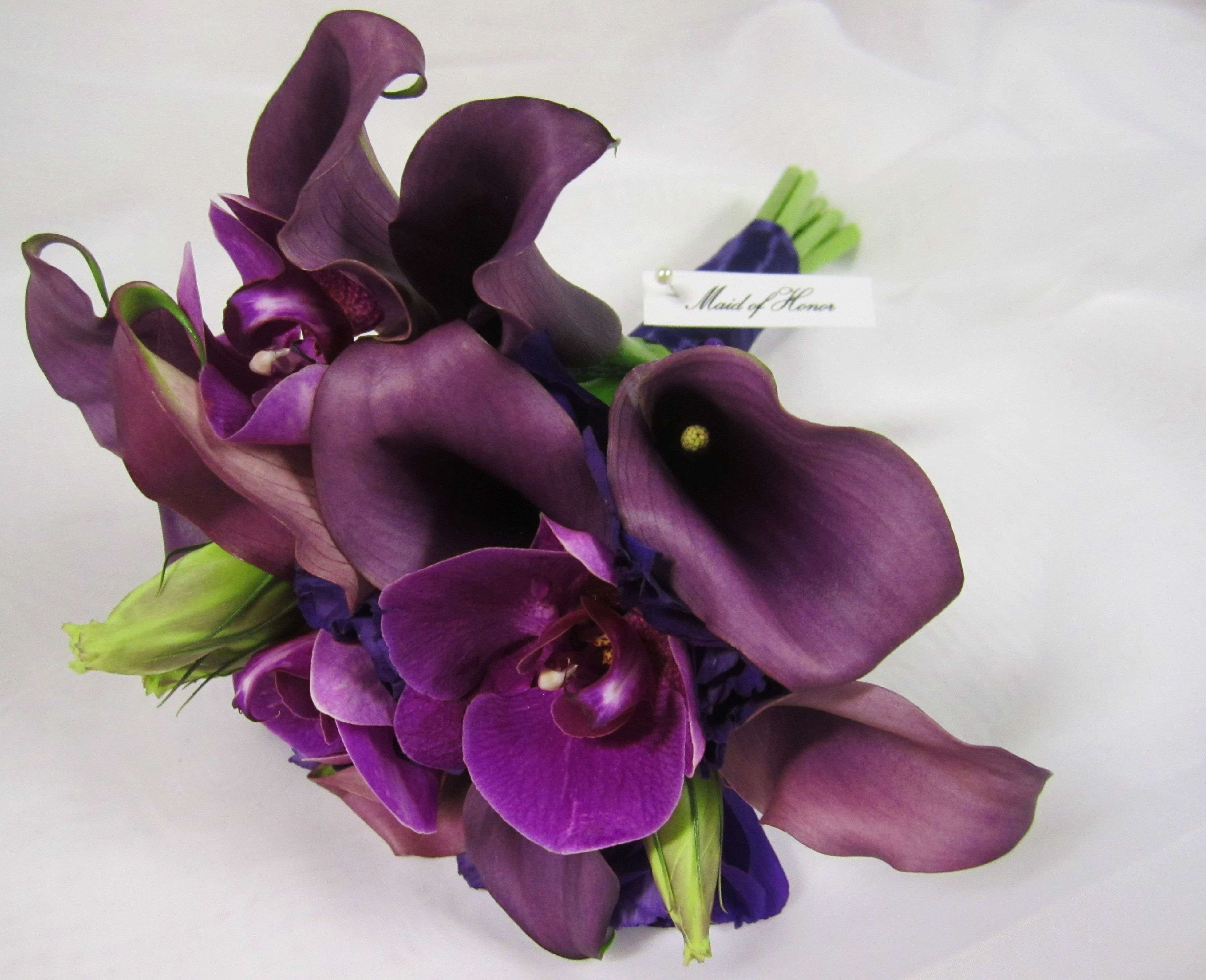 Maid of Honor bouquet of callas, lisianthus and phalaenopsis orchids; design by Davis Floral Creations