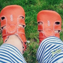 These awesome orange sandals are made from upcycled leather.