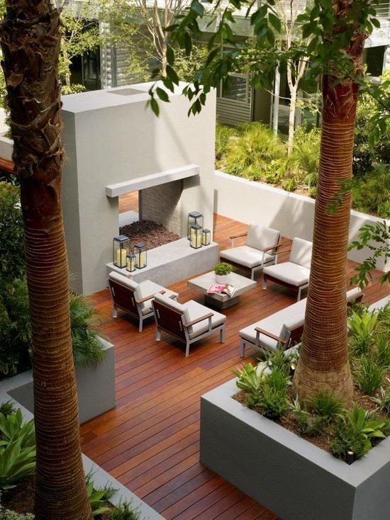 Terrasse Gestalten Ideen Garten Dielenboden Lounge Bereich Kamin Palmen