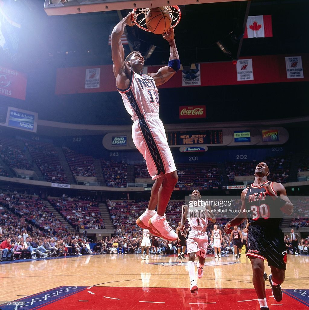 Kendall Gill 13 of the New Jersey Nets dunks against the Miami