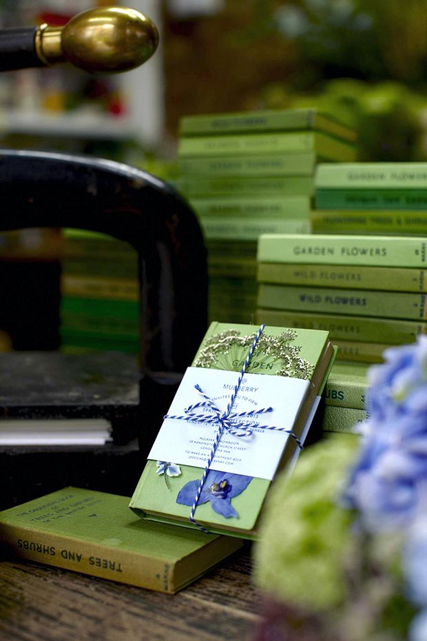 Mulberry invitations for London Fashion Week with miniature books related to British Gardens, all sourced from vintage and second-hand bookshops and decorated with pressed flowers. It's stunning!