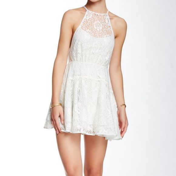 NWT wish upon a star free people dress In ice l:  Nylon   Color:  Ice Combo Condition:  New with tag Description: From Free People.  Ice blue lining with ivory and silver metallic lace overlay.  Sheer back.  Back zip.   Absolutely beautiful dress Free People Dresses Mini