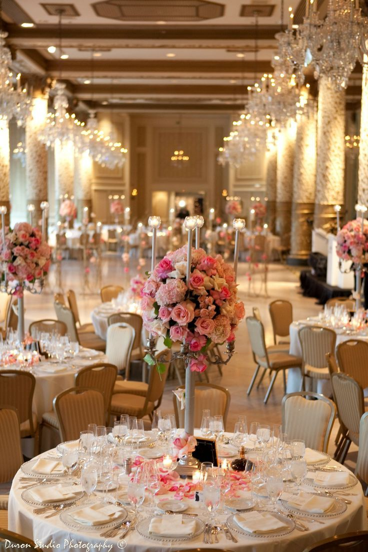 glamorous gold reception with tall floral centerpieces