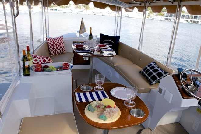 Duffy electric boat interior rides land sea air for Table design yacht