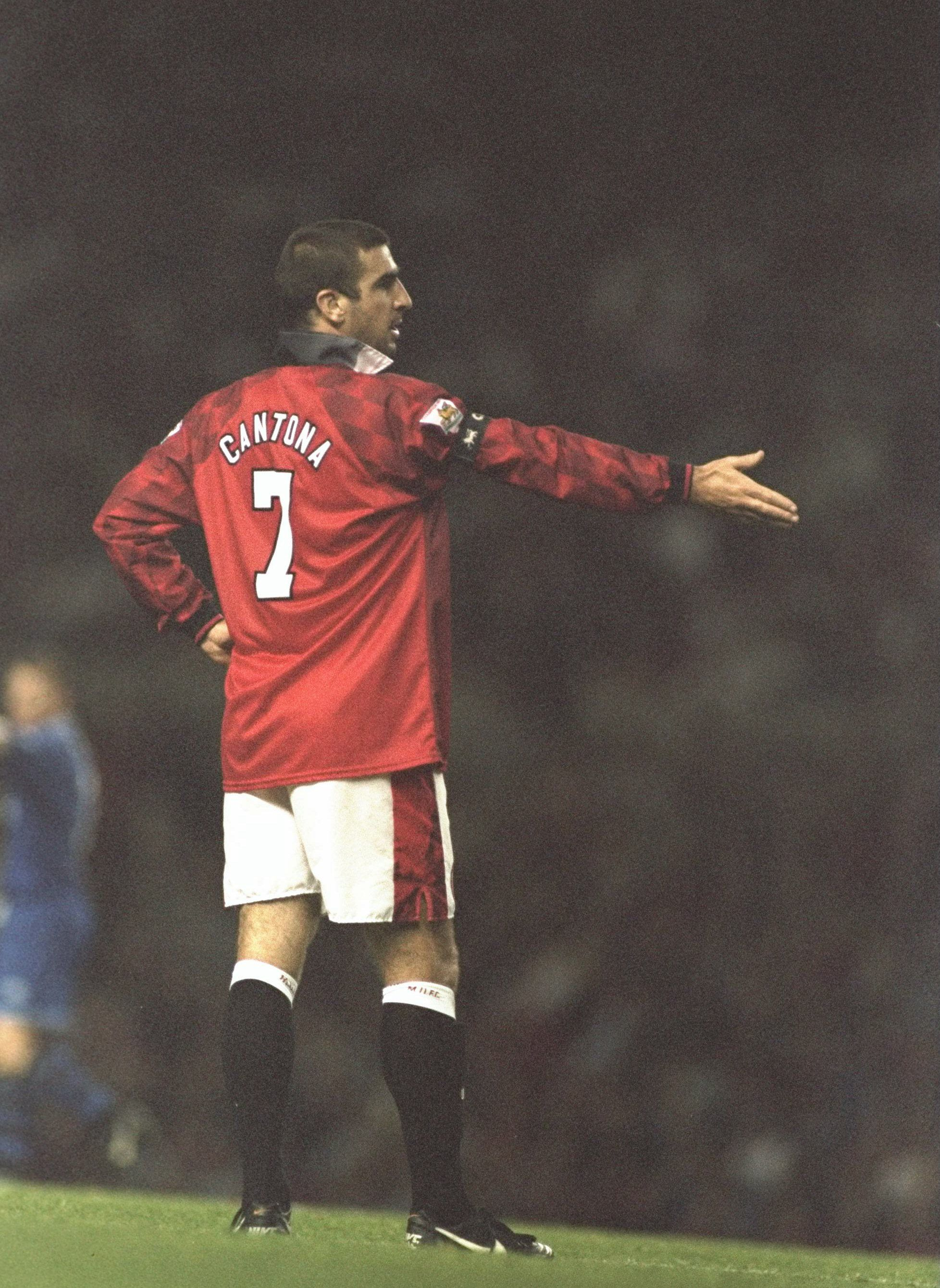 Eric Cantona In Typical Nonchalant Pose Eric Cantona Manchester United Football Club Manchester United Team