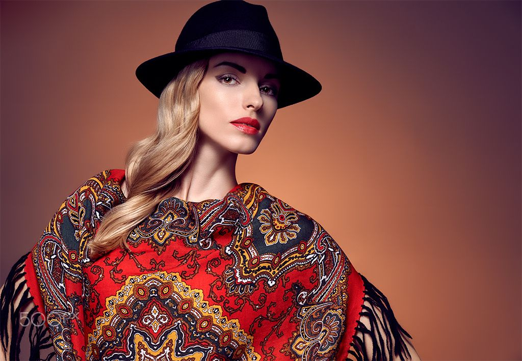 Fashion beauty woman in stylish hat shawl, autumn - Fashion beauty woman in stylish hat and colored shawl. Autumn winter model blond girl with long blonde wavy hair in ethnic pattern headscarf. Unusual creative attractive people.Retro Vintage,copyspace