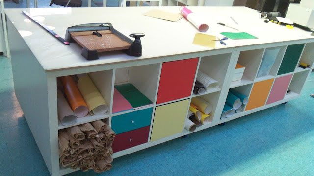 Create a Large Mobile Workstation with Built-in Storage out of IKEA Bookshelves and Some Board