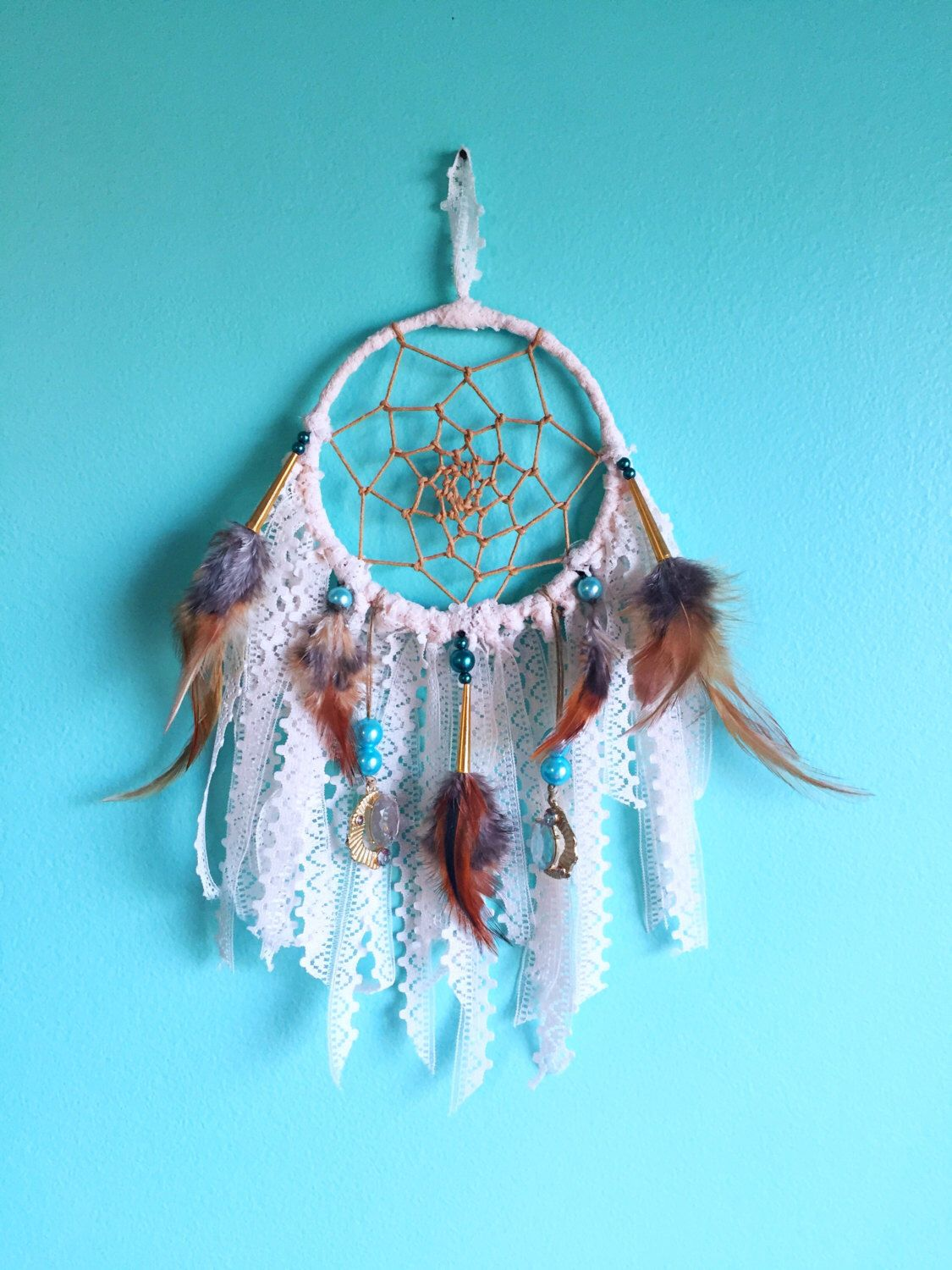 Boho hippie style dreamcatcher with lace feathers and teal turquoise pearls authentically made by ojibwe crafter by EarthDiverCreations on Etsy https://www.etsy.com/ca/listing/478011890/boho-hippie-style-dreamcatcher-with-lace
