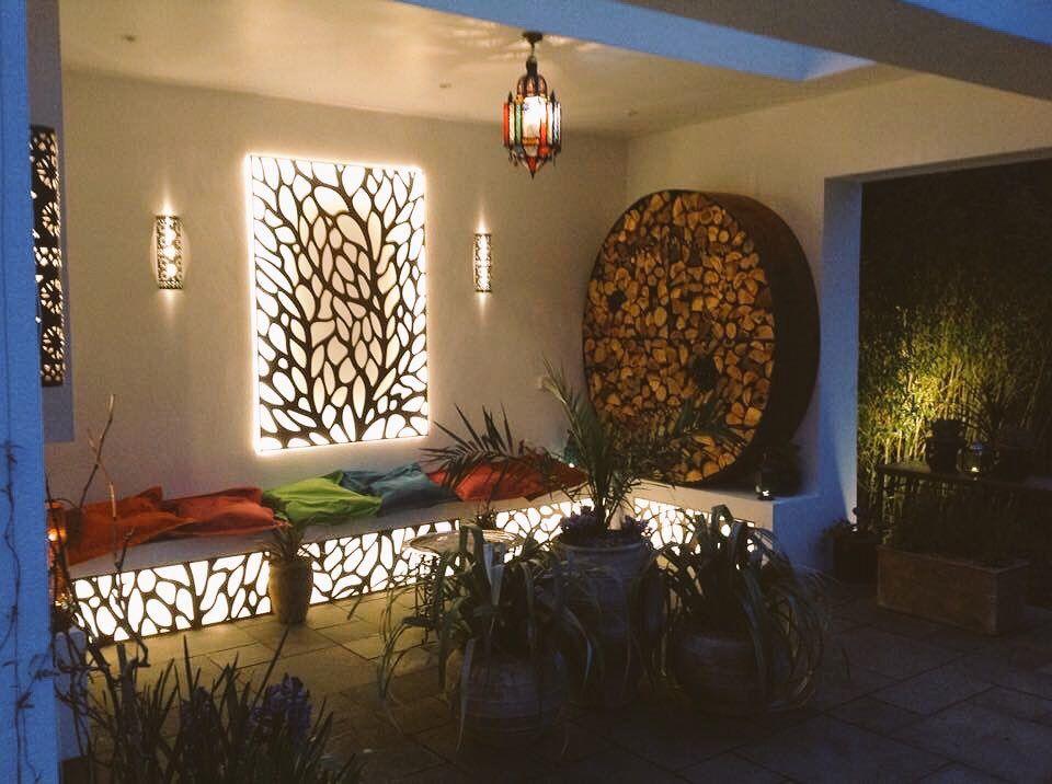 Backlit Laser Cut Screens In A Courtyard Garden Autumn