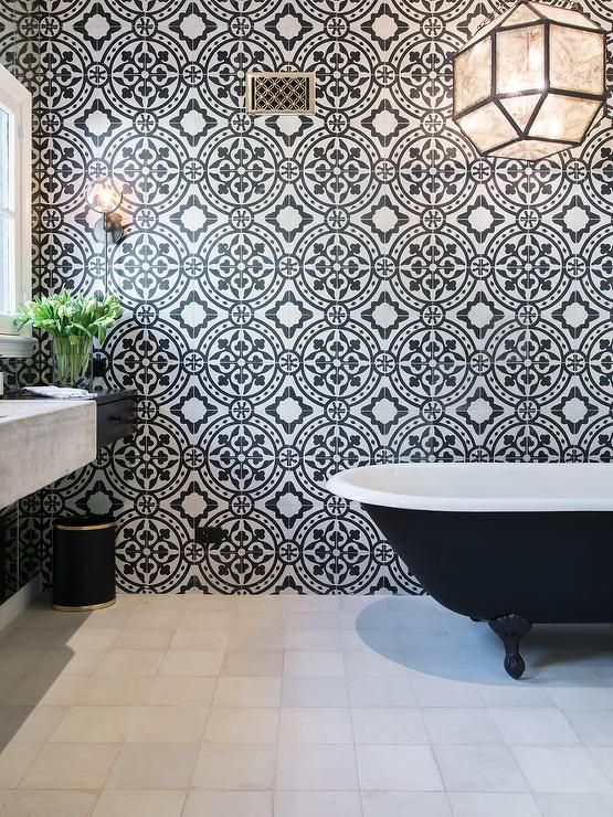 White And Black Bathroom Features An Accent Wall Clad In Black And