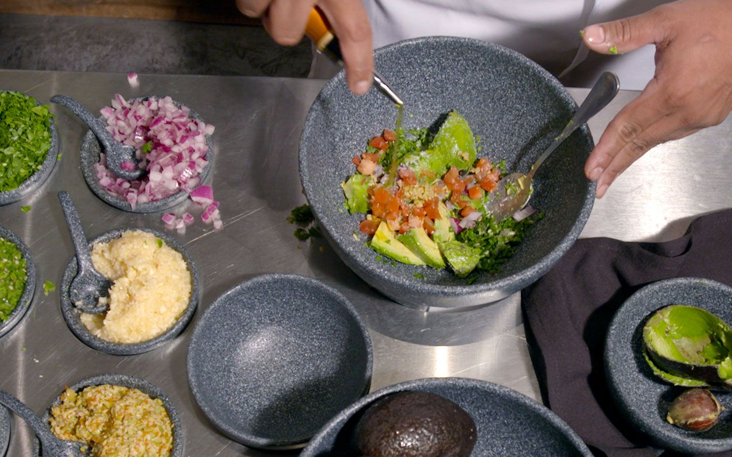 Create the guacamole from antojitos authentic mexican food