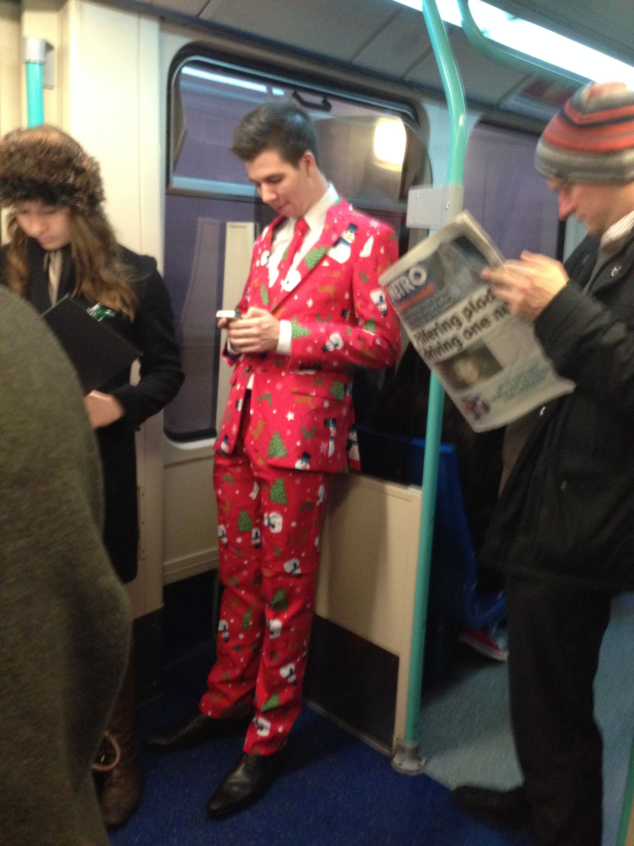 Forget Your Xmas Jumper, Check This Guy On The Tube