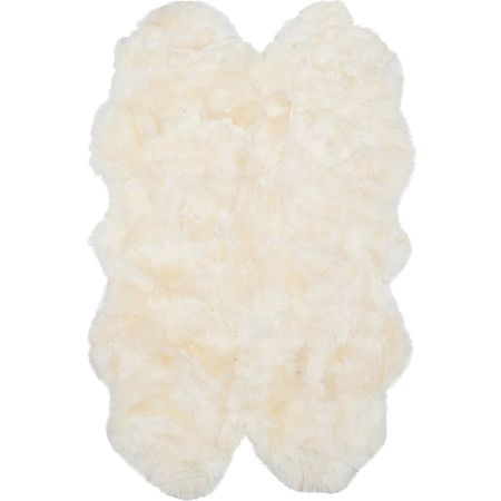 Luxurious on its own or layered atop a complementing rug, this hand-woven sheepskin design brings a touch of Hollywood glamour to your living room or master ...