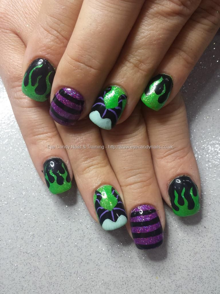 Green and purple glitter with freehand disney malifacent nail art ...