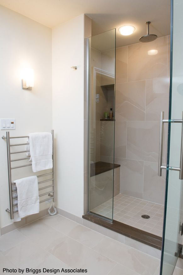 Large Shower With A Rainfall Shower Head A Shower Bench And Of