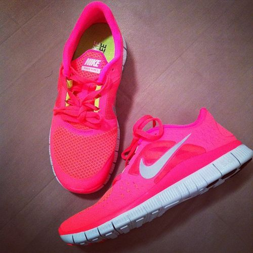 359f0a1bebc0 Bright pink nikes with yellow on the inside