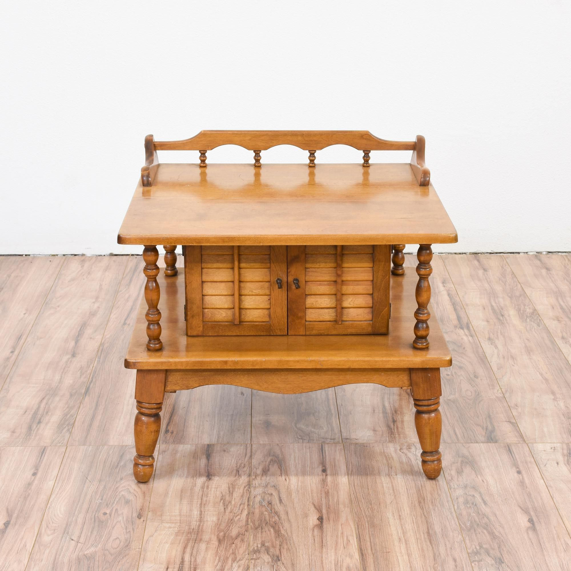 This colonial end table is featured in a solid wood with a glossy