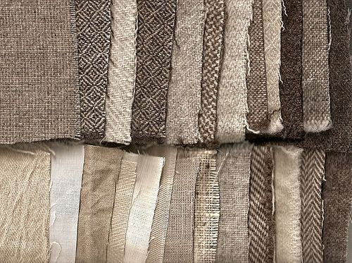 Swatches of various undyed handwoven fabrics in weights and weaves appropriate to early period fabrics