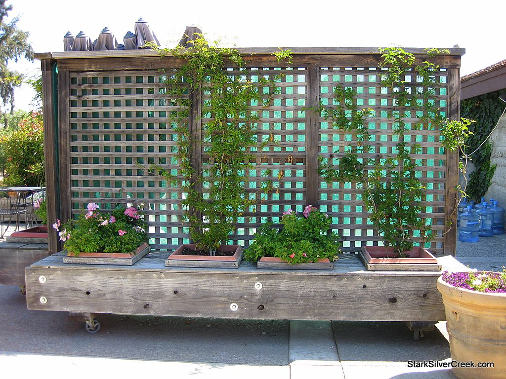 movable privacy fence on casters with built in planters
