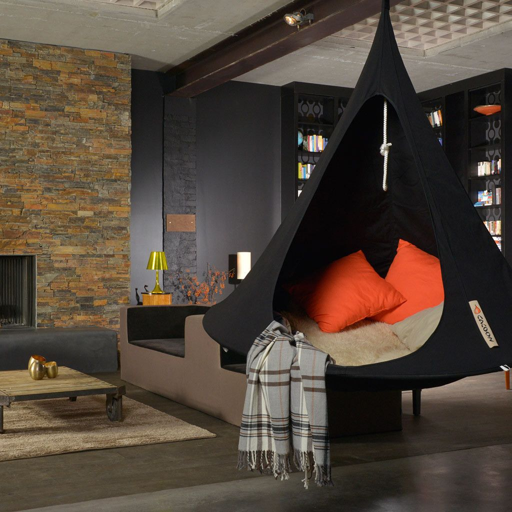 Love this modern style home with indoor cacoon hammocks