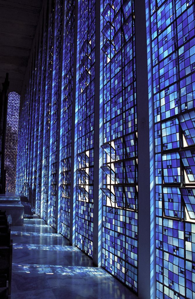 Dom Bosco Church by Carlos Alberto Naves in Brasilia, Brazil. The windows of the Dom Bosco Shrine are made of small squares of stained glass in 12 different shades of blue with dots of white, designed by Naves and manufactured by Belgian artist Hubert Van Doorne in São Paulo.   #Dom Bosco Church #Carlos Alberto Naves #Brasilia #Brazillian architecture #stained glass #blue glass #blue