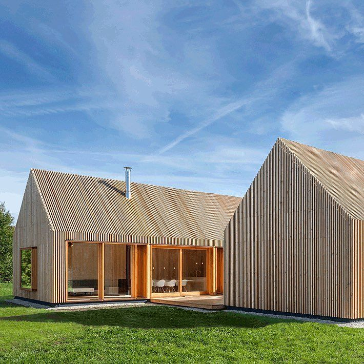 Narrow strips of wood screen both walls and windows at for Wohncontainer vorarlberg