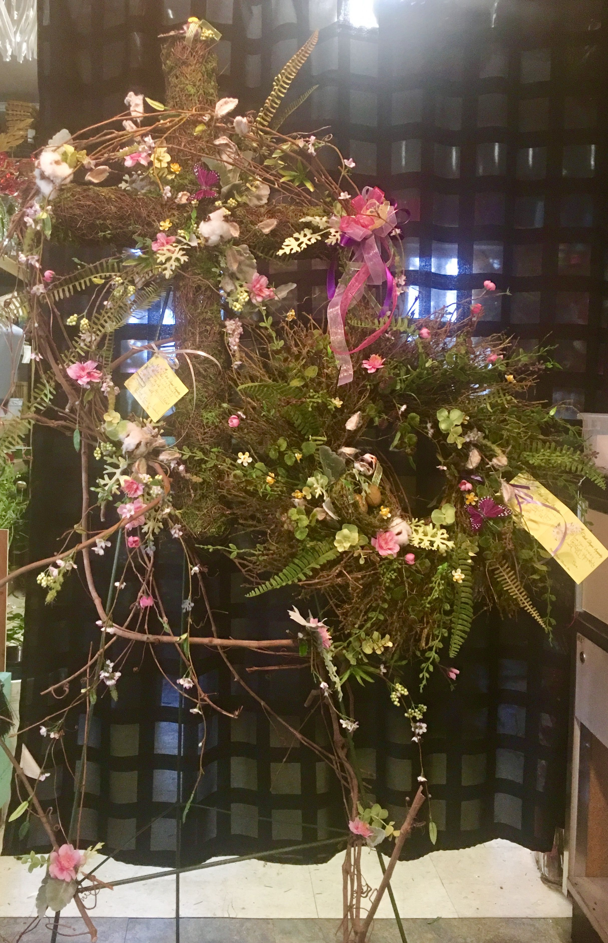 Moss Cross And Wreath With Grapevine And Flowers For Funeral Service