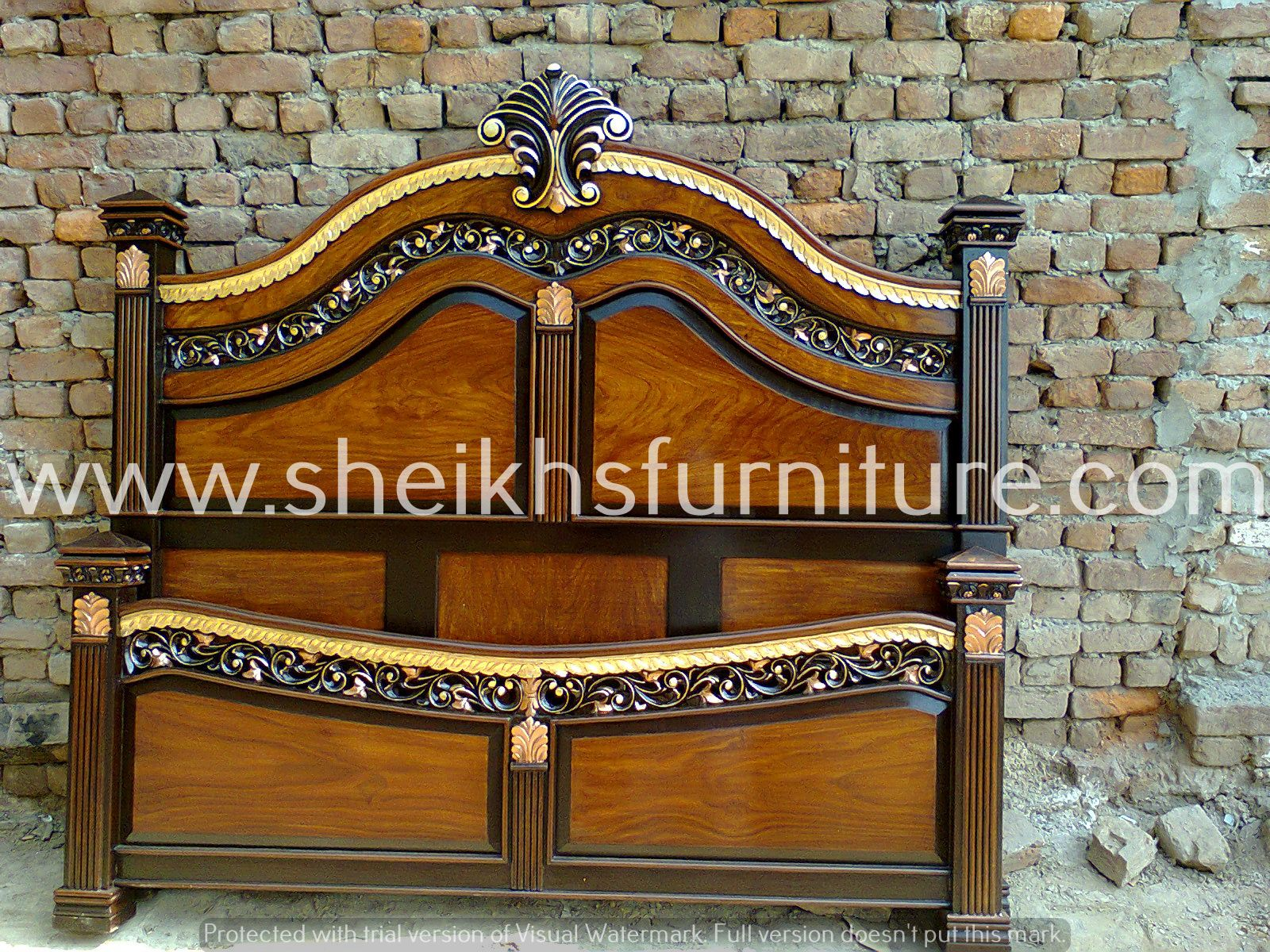this is our solid rosewood bed. this bedroom set is made in pure