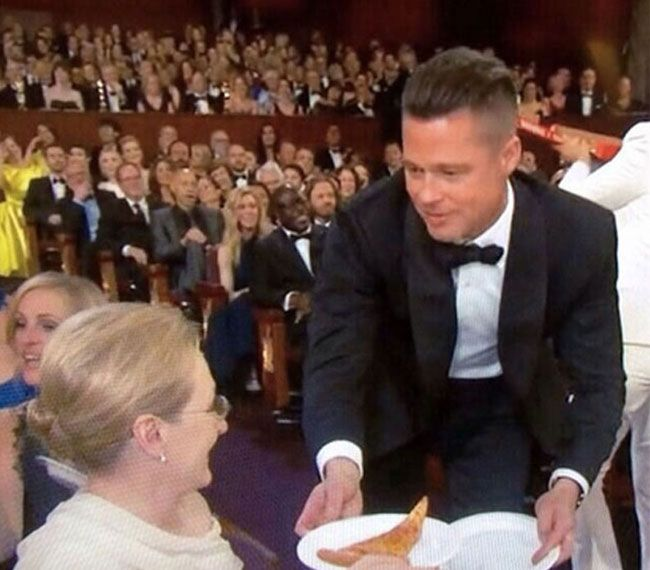 Brad with pizza and Meryl at the 2014 Oscars