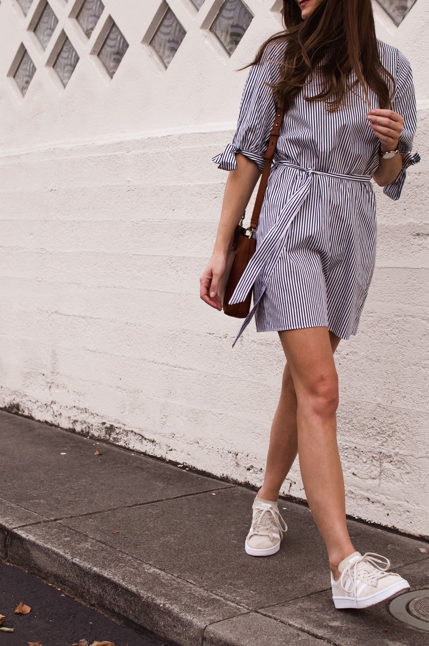 Striped Dress And Sneakers Girl Meets Gold Casual Dress Outfits Dress With Sneakers Outfits [ 2256 x 1500 Pixel ]