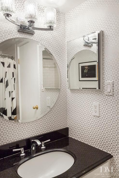 Black And Silver Bathroom Features Walls Clad In Silver Geometric