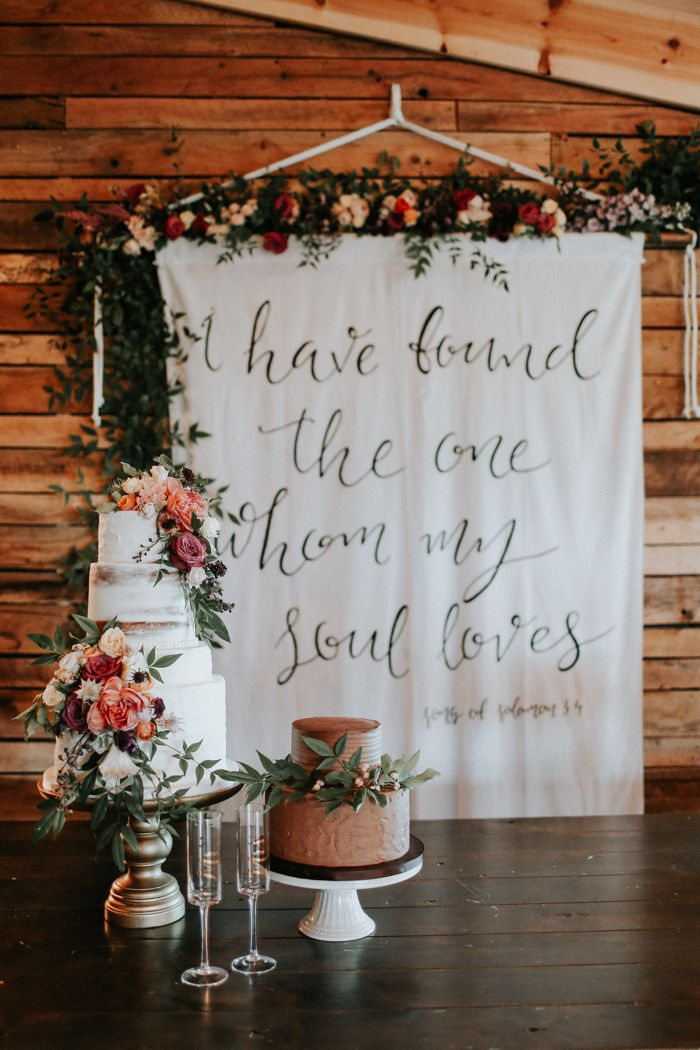 Bible verse enscripted wedding reception tapestry| Image by Melissa Marshall