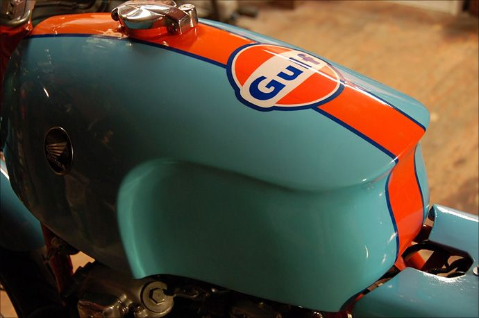 Painted In Gulf Racing Colors This 1975 Honda Cb550 Has Some Pretty Trick Parts Brake Light Custom Gas Tank A Cafe Racer Motorcycle Tank Classic Motorcycles